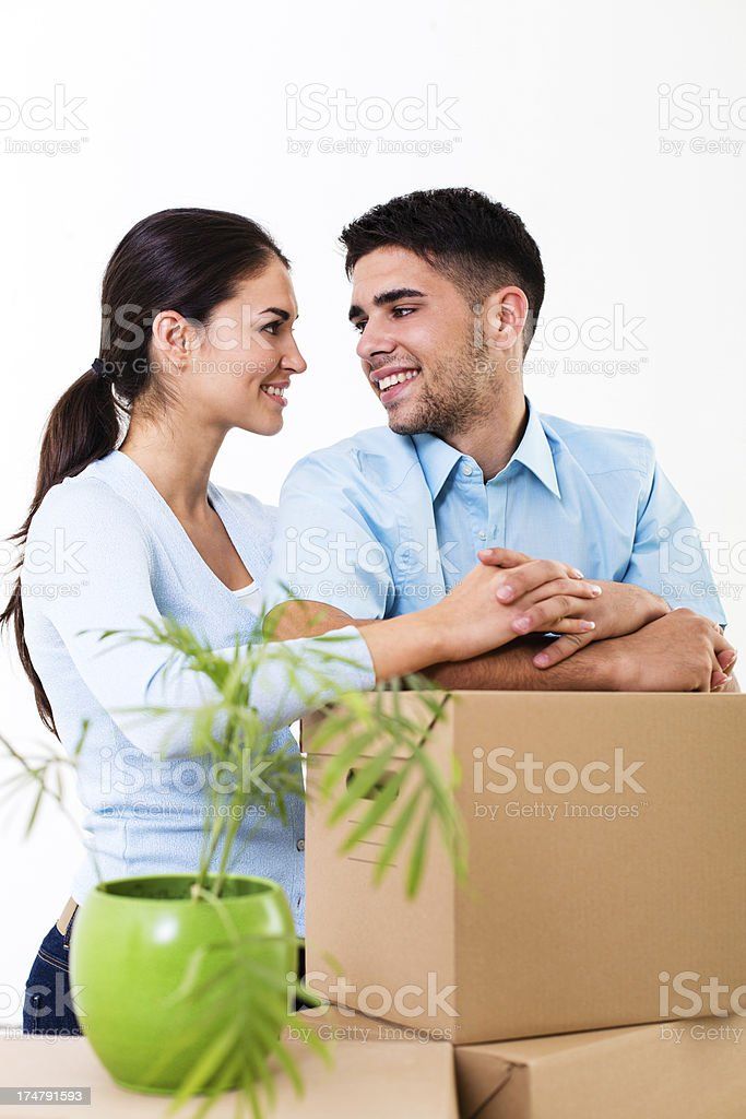 Couple with moving boxes in new home stock photo