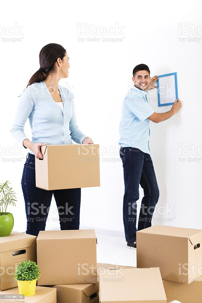 Couple with moving boxes in new home royalty-free stock photo