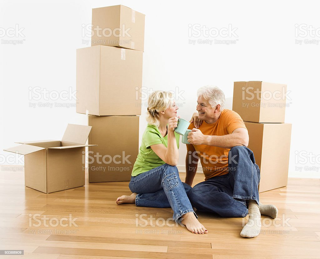 Couple with moving boxes. royalty-free stock photo