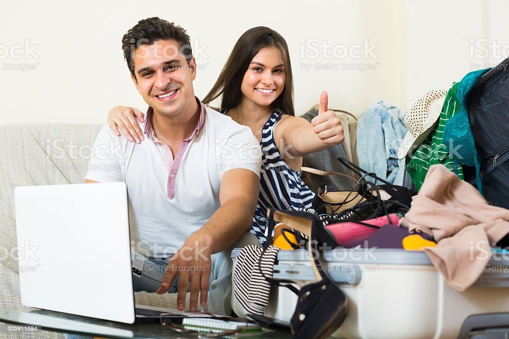 Couple with notebook and credit card stock photo