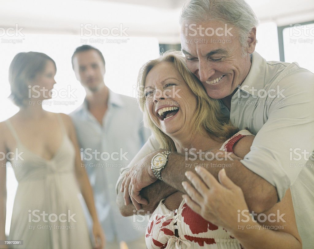 Couple with parents stock photo