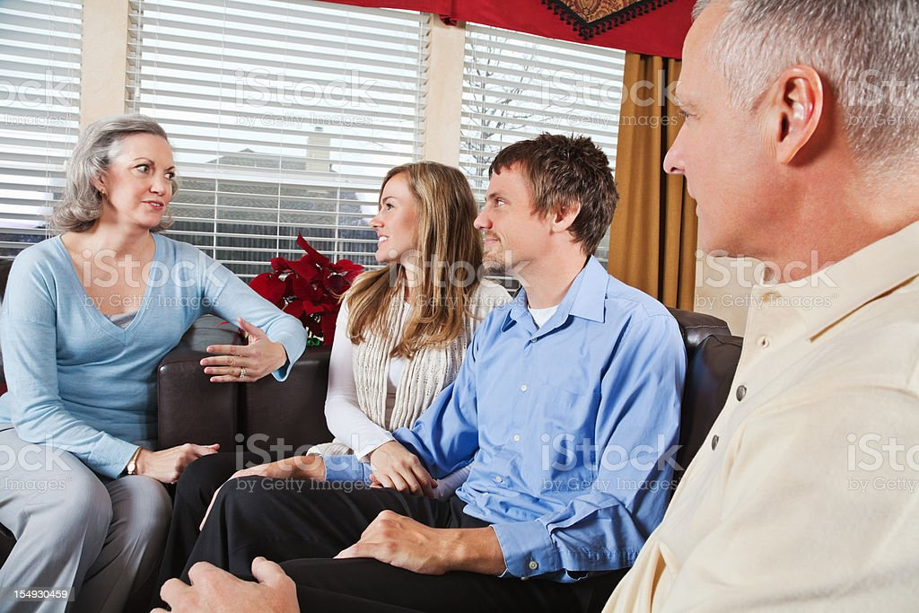 Couple With Parents Talking in the Living Room royalty-free stock photo