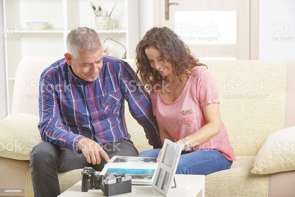 Couple with photo album stock photo