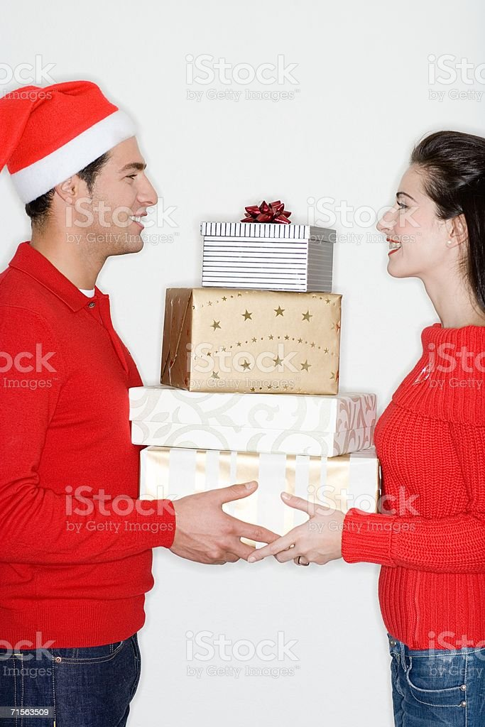 Couple with pile of christmas presents stock photo