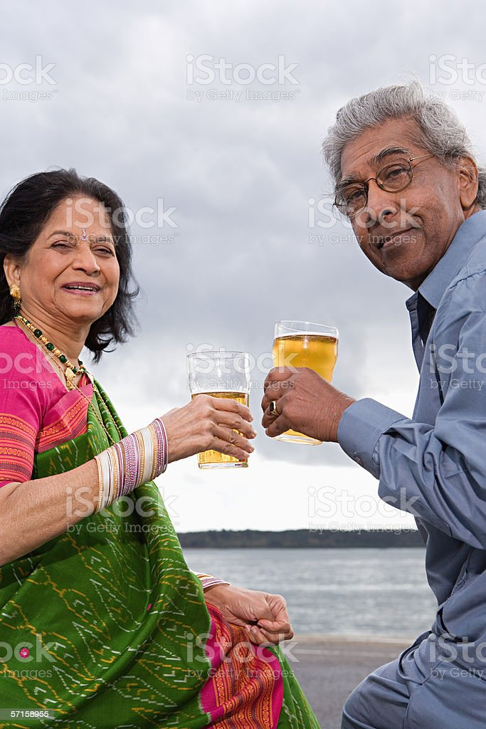 Couple with pints of beer stock photo