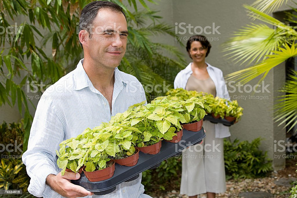 Couple with plants stock photo