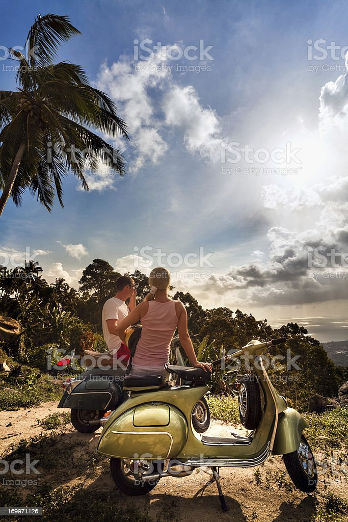 Couple with retro bike on vacation royalty-free stock photo