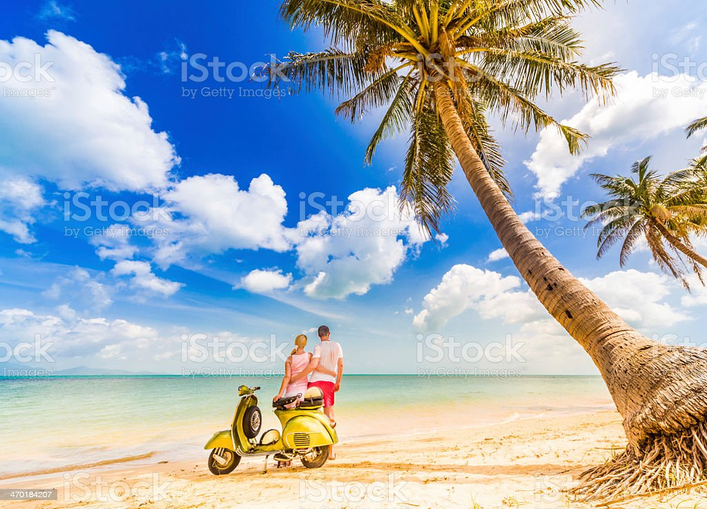 Couple with retro bike on vacation stock photo