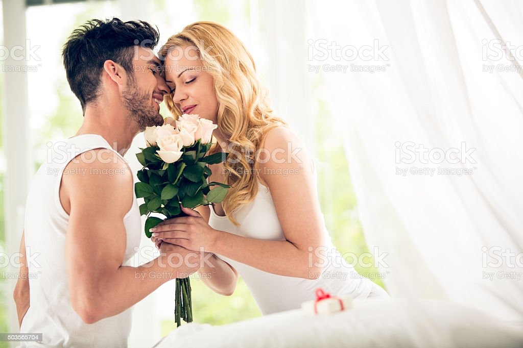 Couple with roses bouquet stock photo