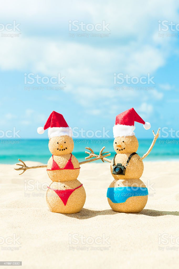 Couple with Santa Hat in Christmas Winter Beach Vacation stock photo