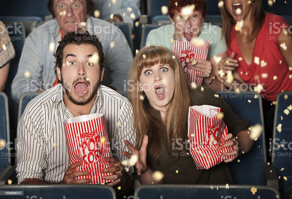 Couple with scary expressions at the movies stock photo