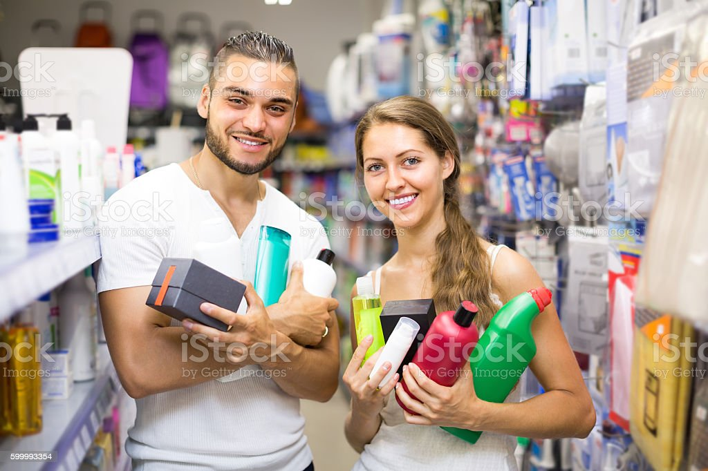 Couple with shampoo in the store stock photo