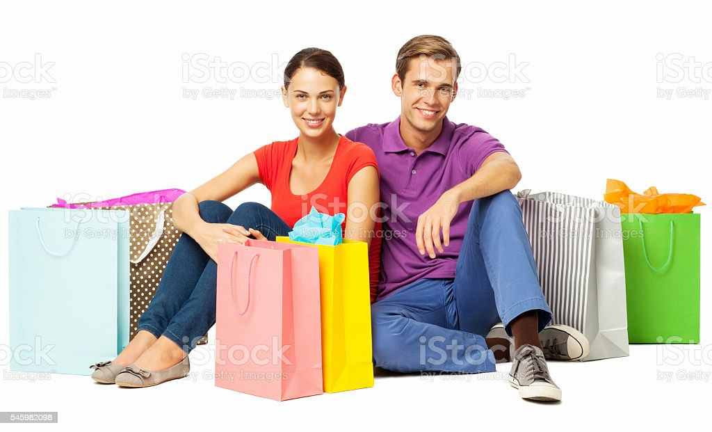 Couple With Shopping Bags Sitting On Floor stock photo