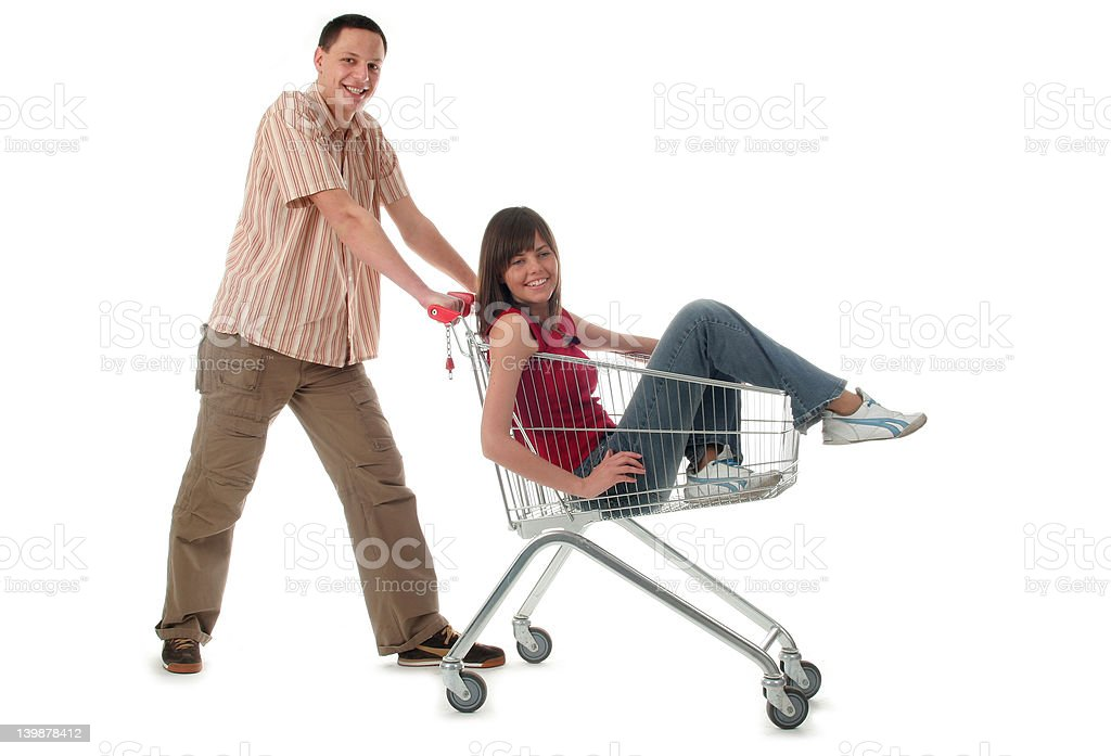Couple with shopping cart royalty-free stock photo