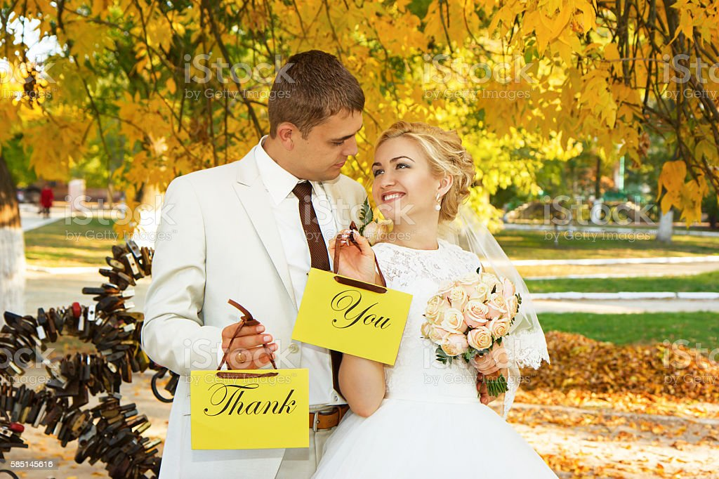 Couple with signs with the words 'Thank' and 'You' stock photo