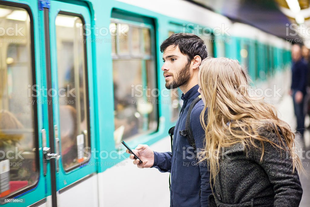 Couple With Smartphone Travelling By Subway stock photo