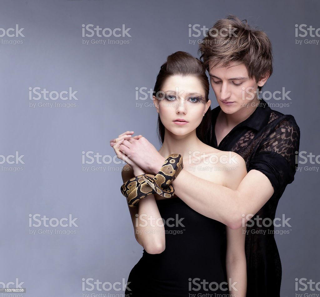 Couple with snake stock photo