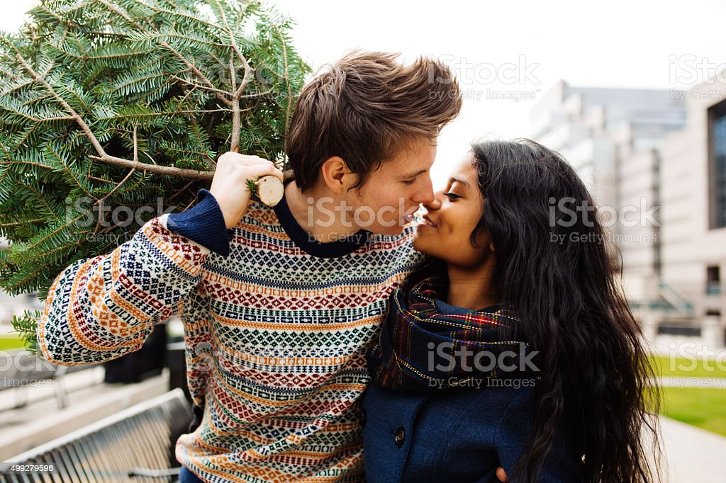 Couple with Spruce tree stock photo