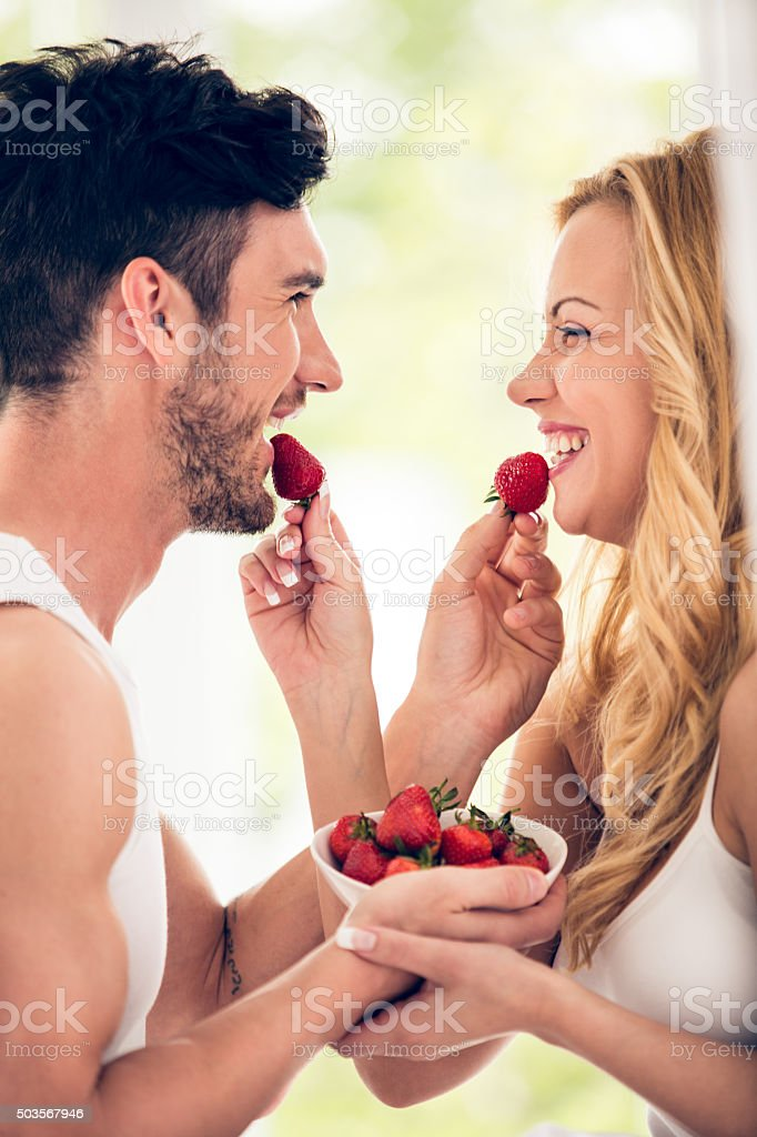Couple with strawberries stock photo