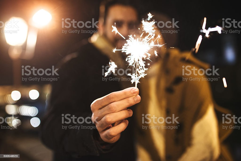 couple with the sparkler for the new year stock photo