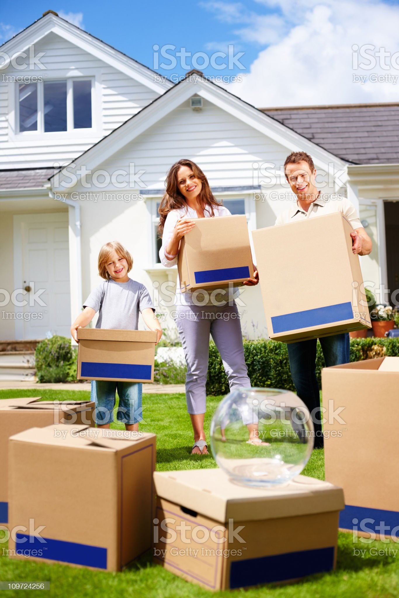 Couple with their son moving in to a new house royalty-free stock photo