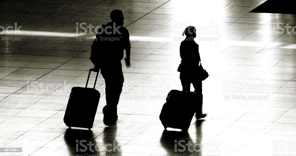 couple with trolleys royalty-free stock photo
