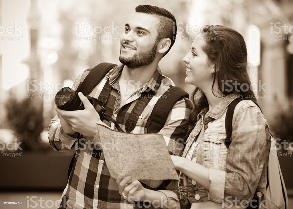Couple with trunk and backpack stock photo