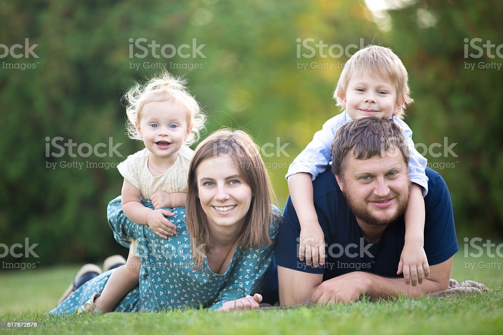 Couple with two kids in park stock photo