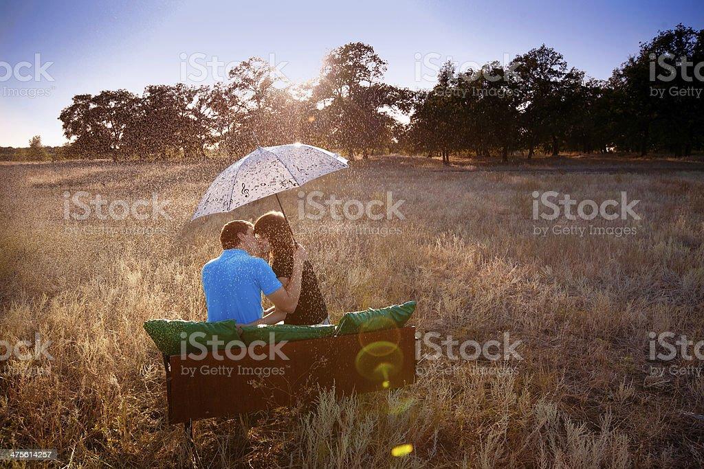couple with umbrella under rain stock photo