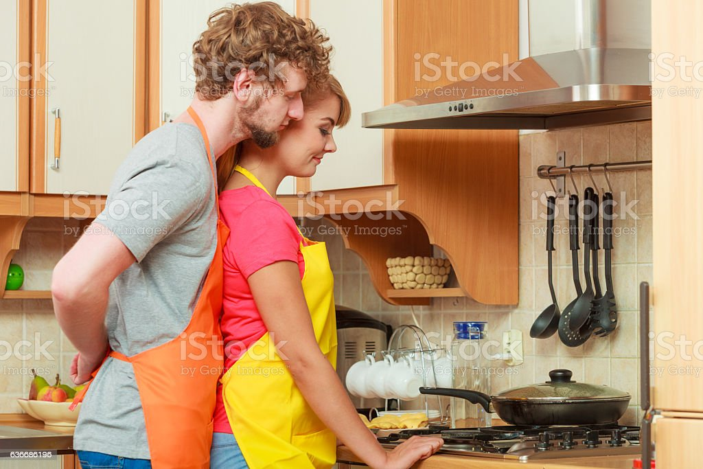 Couple woman and man frying chicken cutlet. stock photo