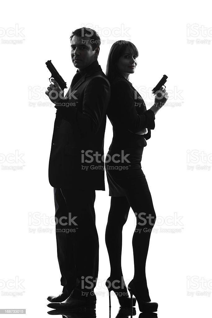 couple woman man detective secret agent criminal  silhouette stock photo