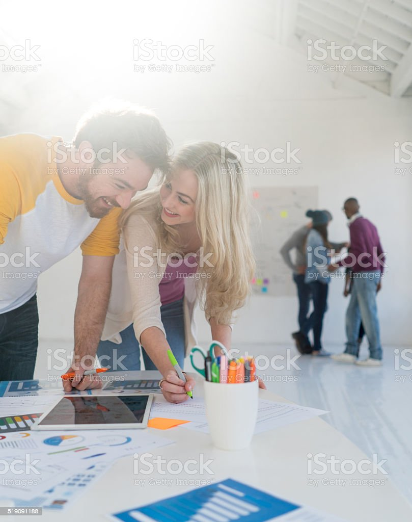 Couple working at a creative office stock photo