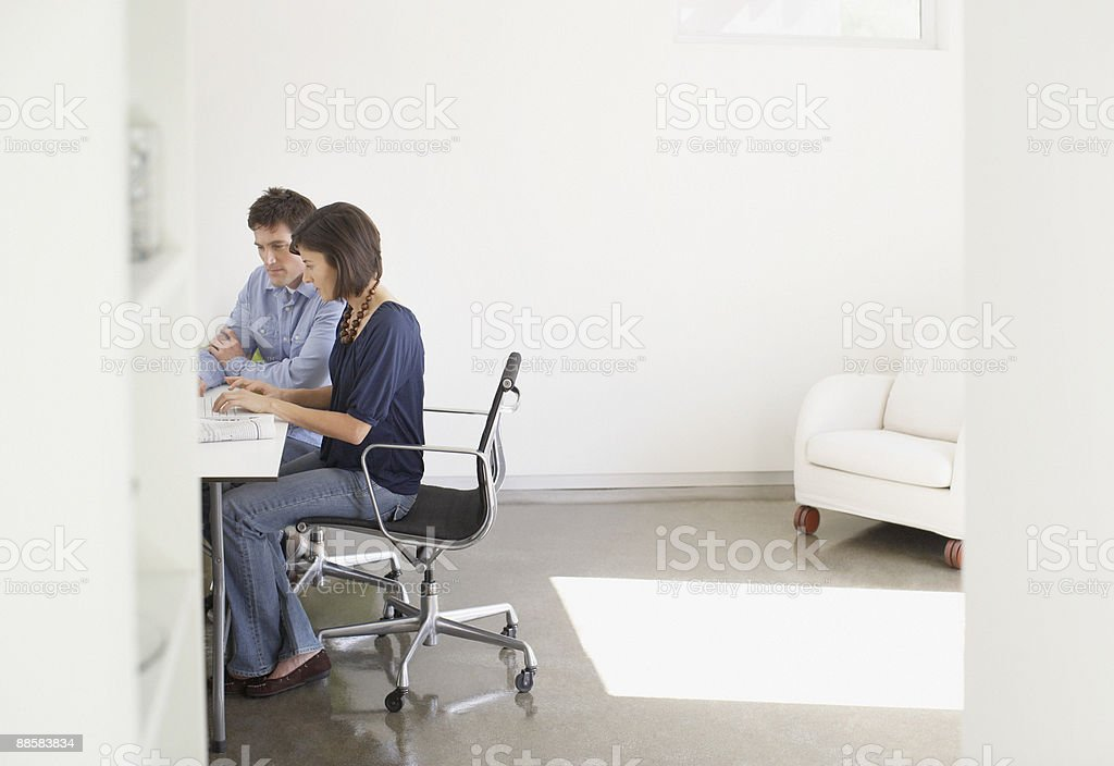 Couple working from home stock photo