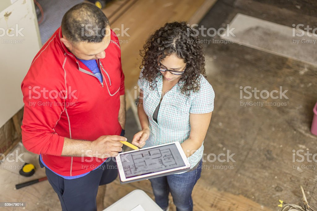 Couple working on DIY remodeling project at home stock photo