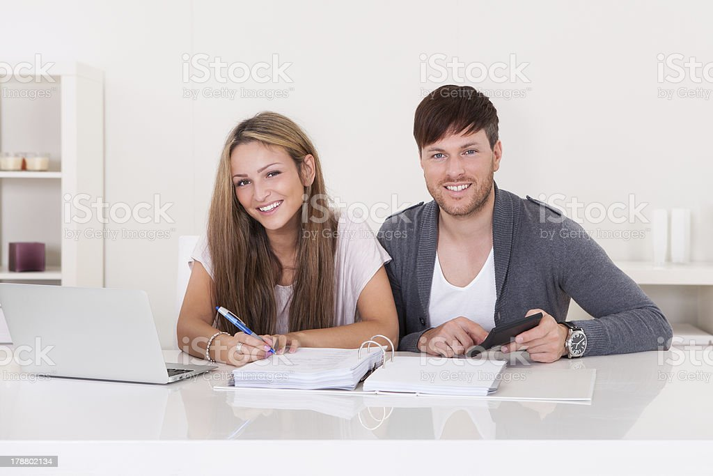 Couple working on expenses royalty-free stock photo