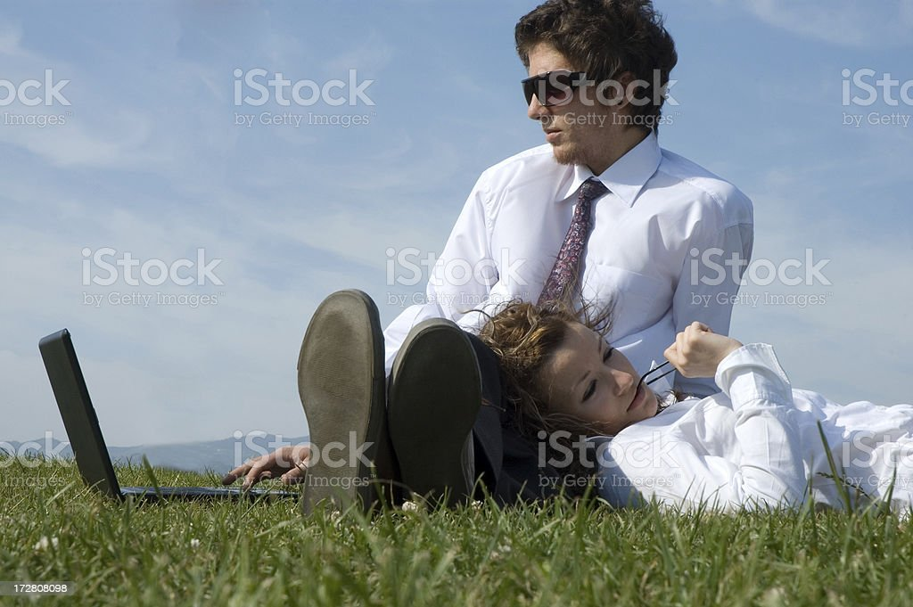 couple working on grass royalty-free stock photo