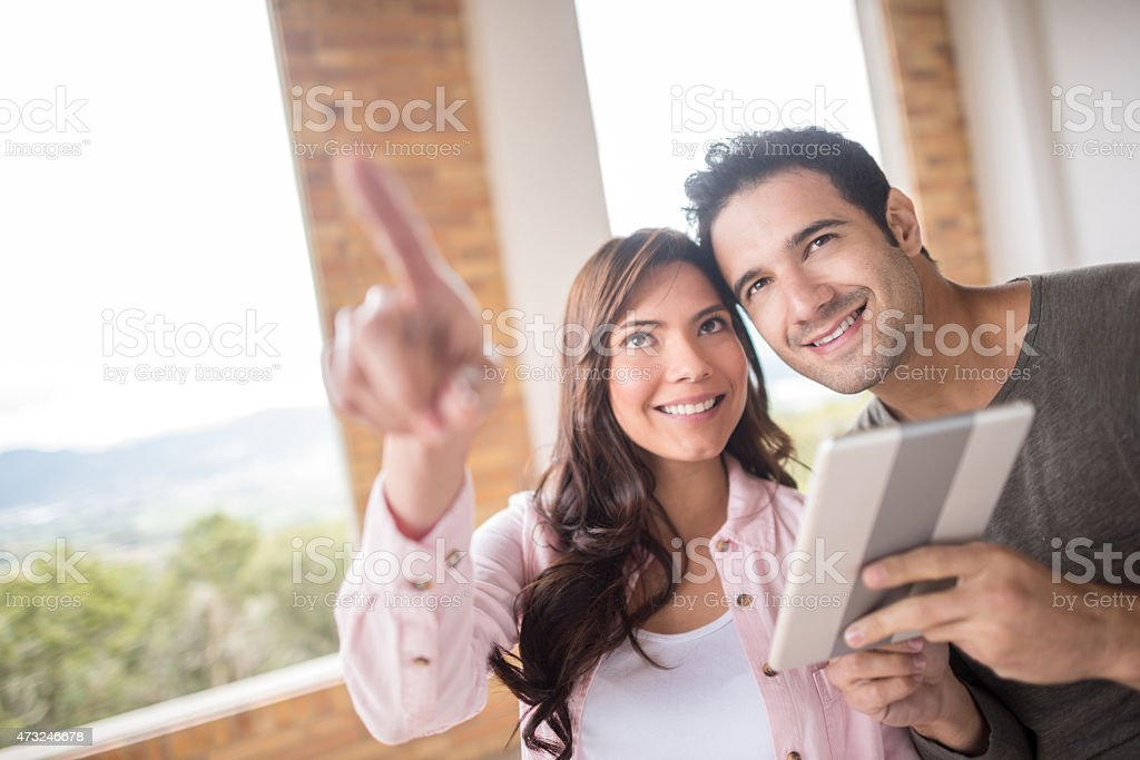 Couple working on home improvement stock photo