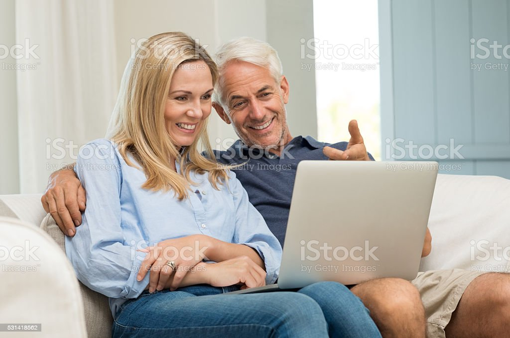 Couple working on laptop stock photo
