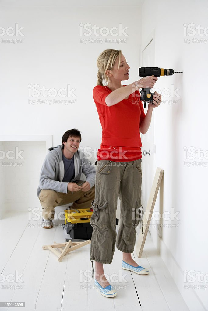 Couple Working On Their New Home stock photo