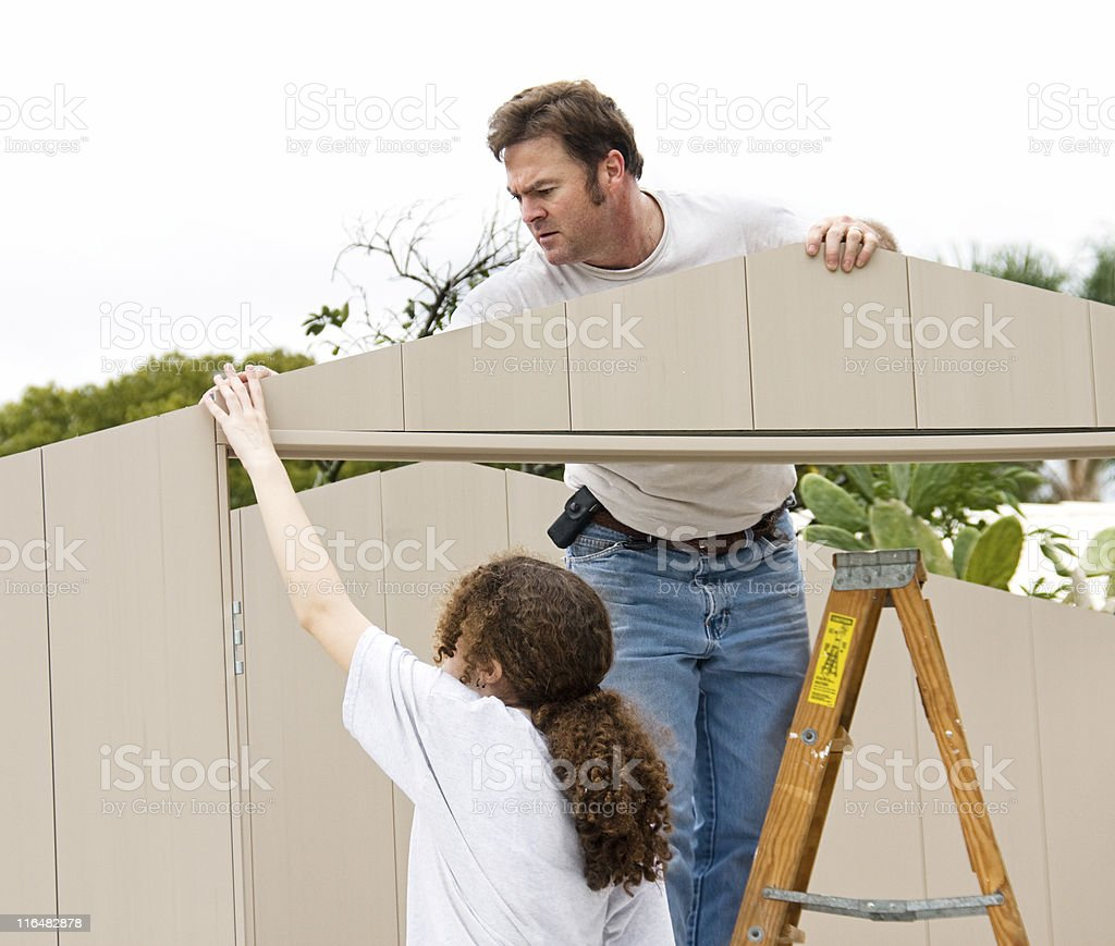 A couple working together to build a shed royalty-free stock photo