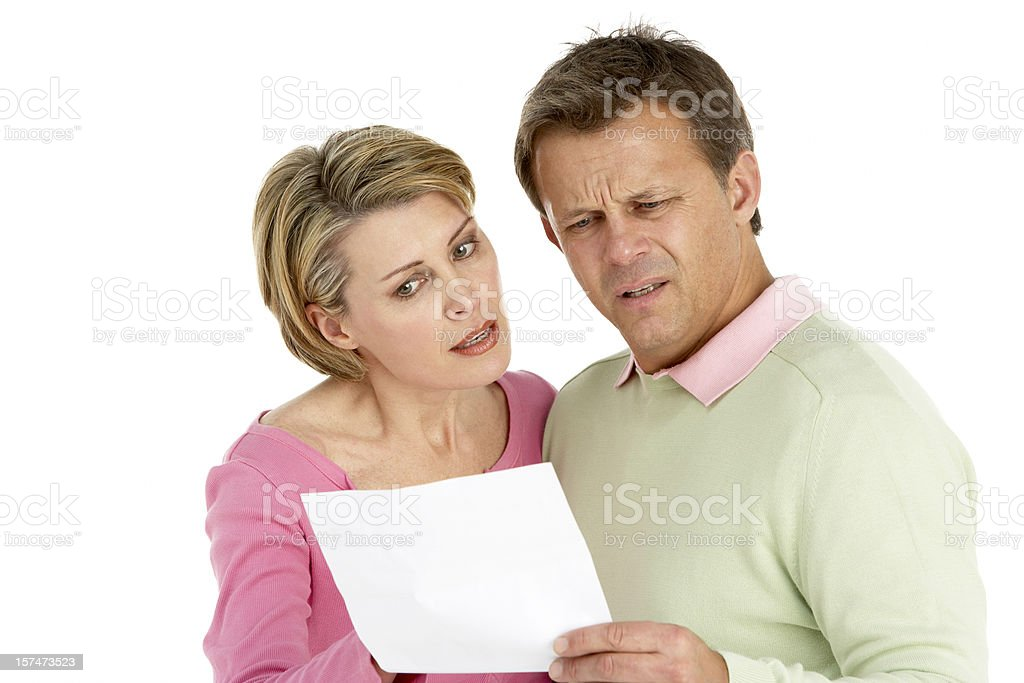 Couple worrying about letter royalty-free stock photo