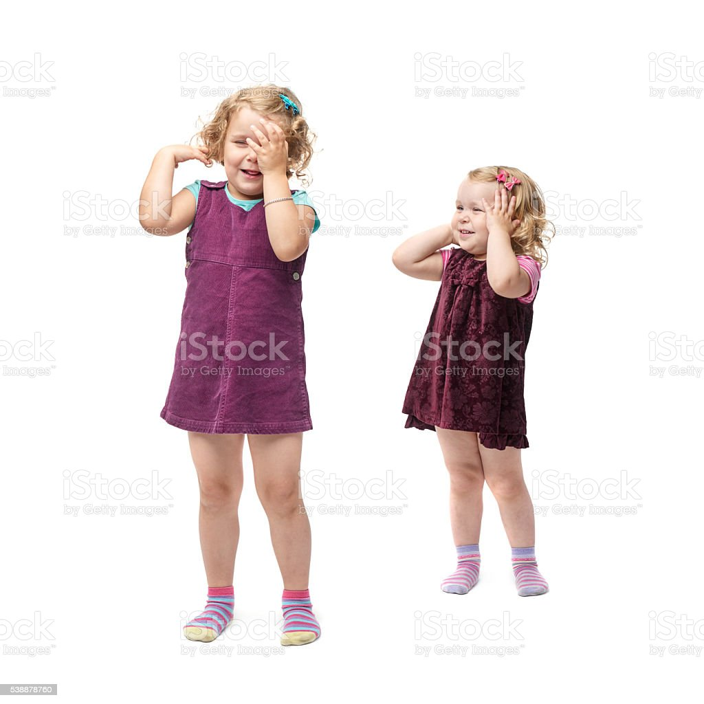 Couple young little girls standing over isolated white background stock photo