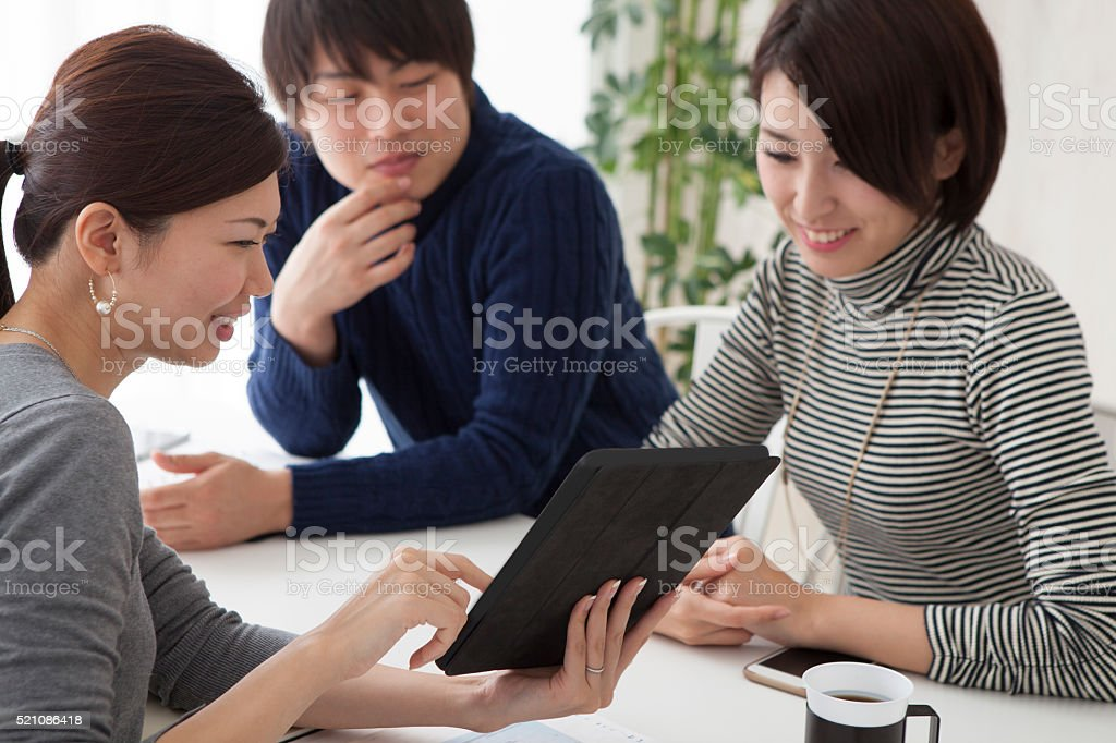 Couples are choosing a house in a real estate agency stock photo