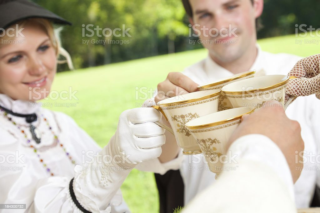 Couples at Victorian Tea Party With Cups Together royalty-free stock photo
