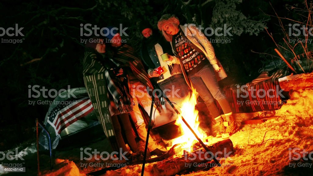 Couples camping in woods stock photo