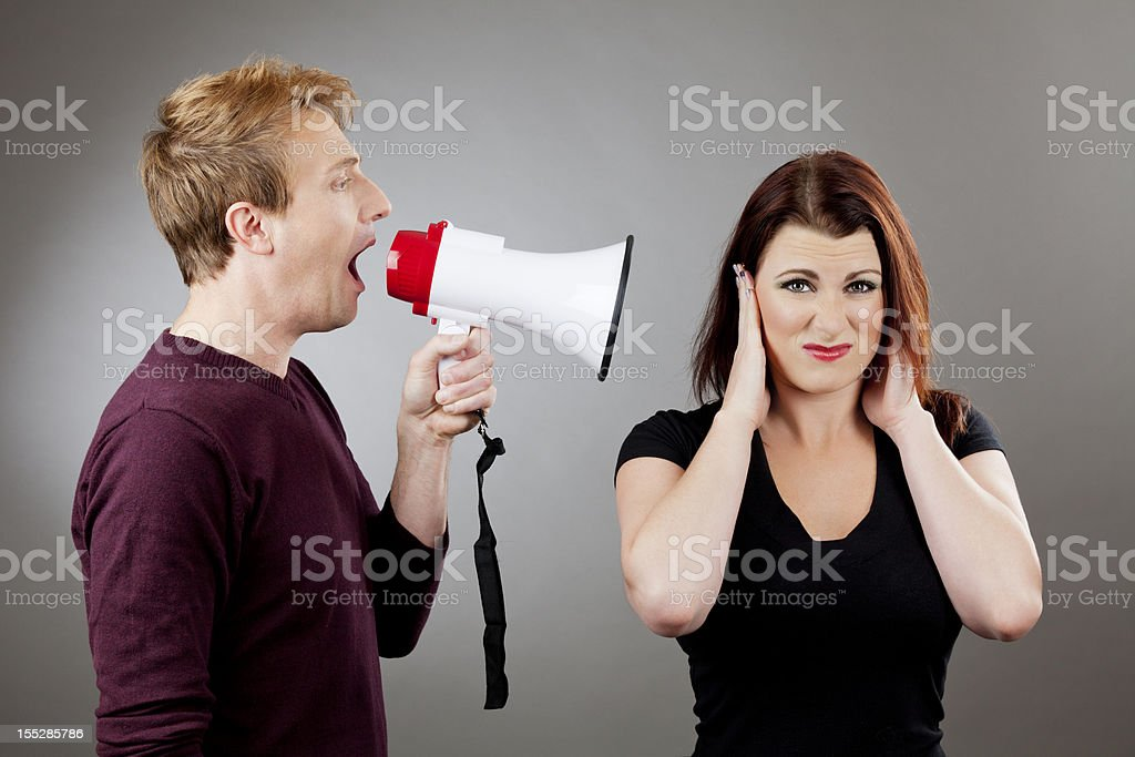 Couple's communication: man yelling at a woman royalty-free stock photo