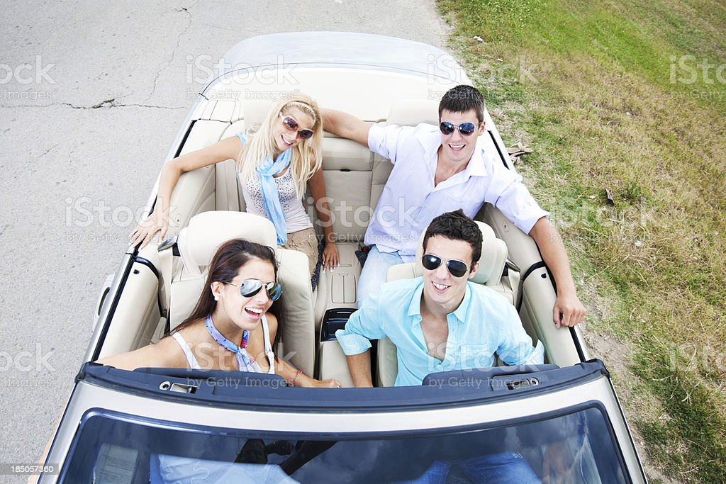 Couples driving in a cabriolet. royalty-free stock photo