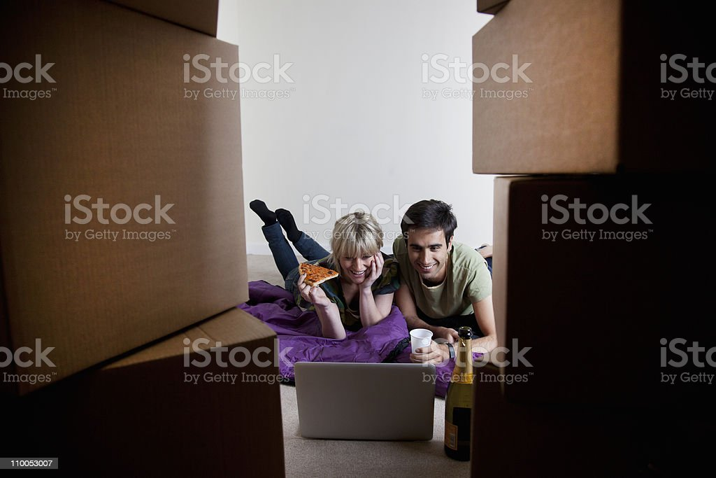 Couples first night in new apartment stock photo