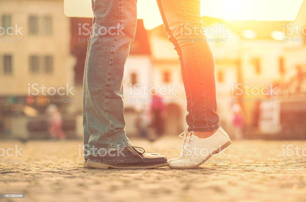 Couples foots stay at the street under sunlight stock photo