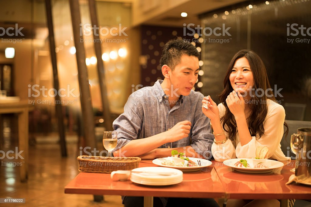 Couples get along to a meal in the restaurant stock photo